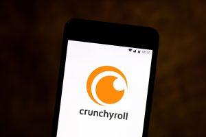 crunchyroll premium apk logo inside a phone.